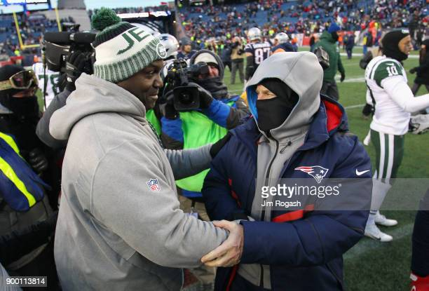Head coach Todd Bowles of the New York Jets shakes hands with head coach Bill Belichick of the New England Patriots after the Patriots defeated the...