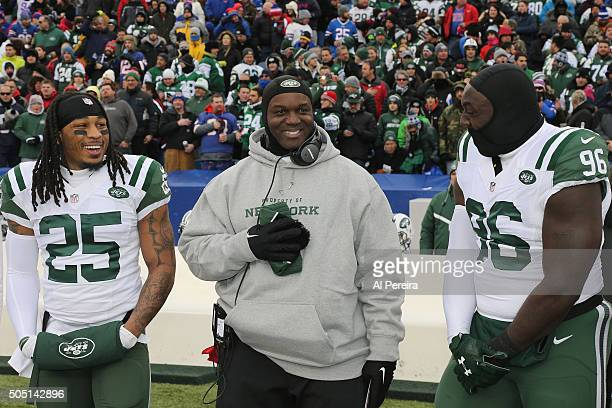 Head Coach Todd Bowles of the New York Jets shares a light moment with Safety Calvin Pryor and Defensive End Muhammed Wilkerson before the game...