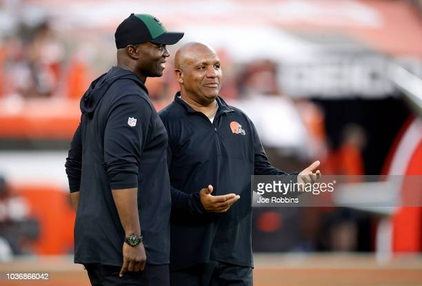 Head coach Todd Bowles of the New York Jets talks with head coach Hue Jackson of the Cleveland Browns prior to the game at FirstEnergy Stadium on...