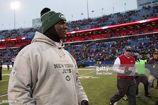 Head Coach Todd Bowles of the New York Jets walks off the field after losing to the Buffalo Bills 2217 at Ralph Wilson Stadium on January 3 2016 in...