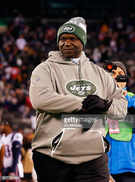 Head coach Todd Bowles of the New York Jets walks off the field after a game against the New England Patriots on November 27 2016 at MetLife Stadium...