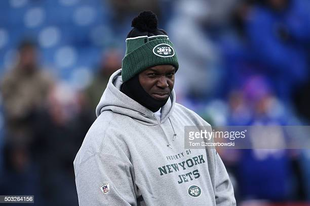Head Coach Todd Bowles of the New York Jets watches warmups before the game against the Buffalo Bills at Ralph Wilson Stadium on January 3 2016 in...