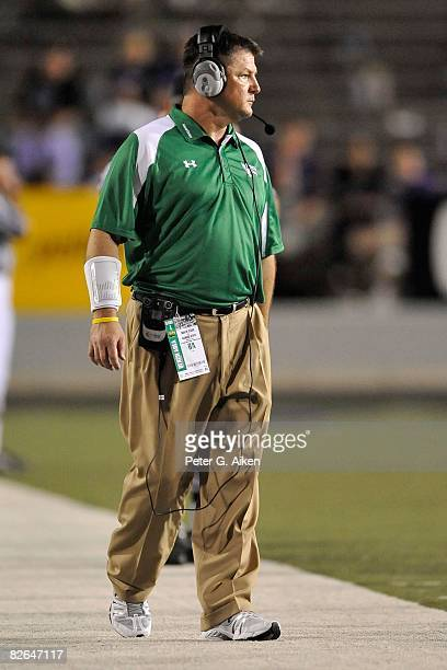 Head coach Todd Dodge of the North Texas Mean Green looks out onto the field during the 4th quarter against the Kansas State Wildcats on August 30...