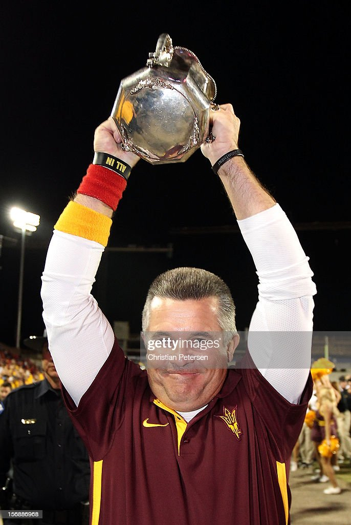 Head coach Todd Graham of the Arizona State Sun Devils celebrates with the Territorial Cup after defeating the Arizona Wildcats 41-34 in the college football game at Arizona Stadium on November 23, 2012 in Tucson, Arizona.