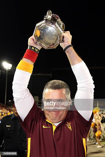 Head coach Todd Graham of the Arizona State Sun Devils celebrates with the Territorial Cup after defeating the Arizona Wildcats 4134 in the college...