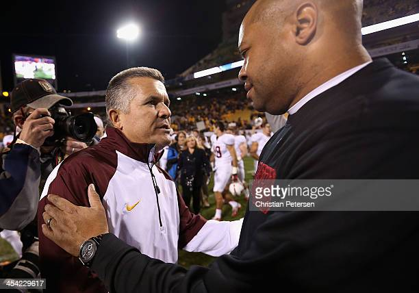 Head coach Todd Graham of the Arizona State Sun Devils shakes hands with head coach David Shaw of the Stanford Cardinal following the Pac 12...