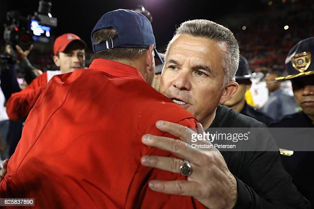 Head coach Todd Graham of the Arizona State Sun Devils shakes hands with Rich Rodriguez following the Territorial Cup college football game at...