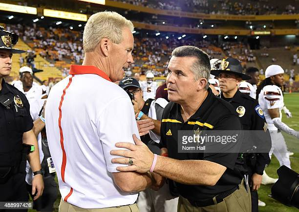 Head coach Todd Graham of the Arizona State University Sun Devils shakes hands with head coach Bob Davie the New Mexico Lobos after the game at Sun...