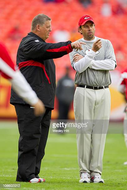 Head Coach Todd Haley and Offensive Coordinator Charlie Weis of the Kansas City Chiefs talk on the field before a game against the Jacksonville...