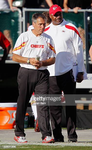 Head coach Todd Haley of the Kansas City Chiefs walks on to the field after defeating the Oakland Raiders on October 23 2011 at Oco Coliseum in...
