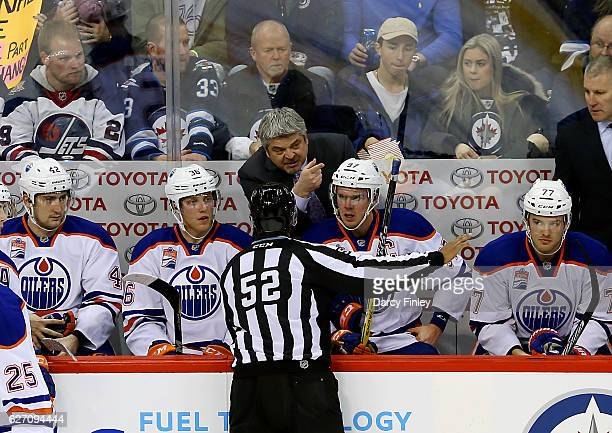 Head Coach Todd McLellan of the Edmonton Oilers has words with linesman Shandor Alphonso during a second period stoppage in play against the Winnipeg...