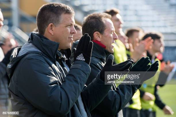 Head Coach Todd Yeagley of Indiana University claps for his team during the Division I Men's Soccer Championship held at Talen Energy Stadium on...