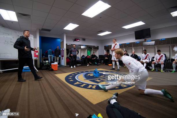 Head Coach Todd Yeagley of Indiana University speaks with his team in the locker room prior to the Division I Men's Soccer Championship held at Talen...