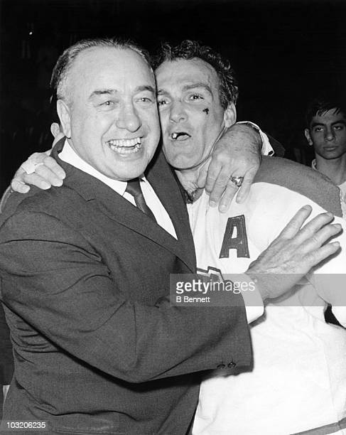Head coach Toe Blake hugs Henri Richard of the Montreal Canadiens after Richard scored the winning goal to win the Stanley Cup during Game 6 of the...