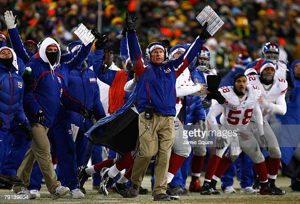 Head coach Tom Coughlin and the New York Giants celebrate as the winning field goal is kicked in overtime of the NFC championship game against the...