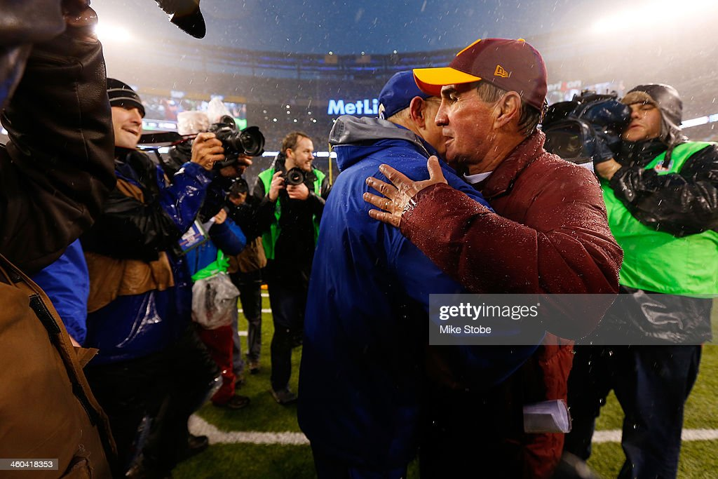 head coach Tom Coughlin of the New York Giants and head coach Mike Shanahan of the Washington Redskins shake hands following the game at MetLife Stadium on December 29, 2013 in East Rutherford, New Jersey. Giants defeated the Redskins 20-6.