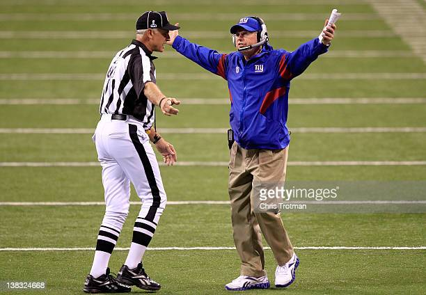 Head coach Tom Coughlin of the New York Giants argues with field judge Gary Cavaletto on the field after a call against the New England Patriots in...