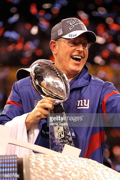 Head coach Tom Coughlin of the New York Giants celebrates with the Vince Lombardi Trophy after defeating the New England Patriots in Super Bowl XLVI...