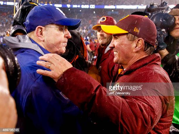 Head coach Tom Coughlin of the New York Giants greets head coach Mike Shanahan of the Washington Redskins after their game at MetLife Stadium on...