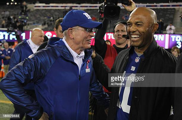 Head Coach Tom Coughlin of the New York Giants meets with former New York Yankees pitcher Mariano Rivera before the New York Giants vs The Minnesota...