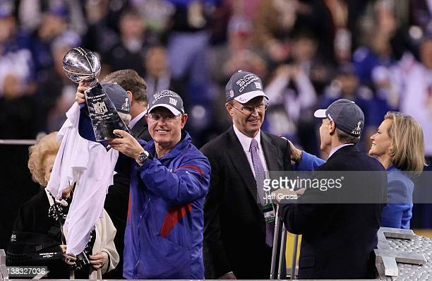 Head coach Tom Coughlin of the New York Giants poses with the Vince Lombardi Trophy after the Giants defeated the Patriots by a score of 2117 in...