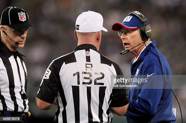 Head coach Tom Coughlin of the New York Giants right talks with referee John Parry during a preseason game against the New York Jets at MetLife...
