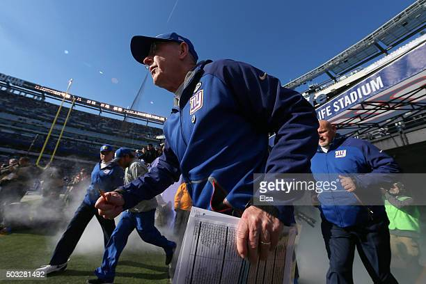 Head coach Tom Coughlin of the New York Giants takes the field prior to their game against the Philadelphia Eagles at MetLife Stadium on January 3...