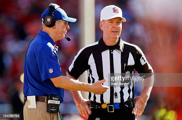 Head coach Tom Coughlin of the New York Giants talks with referee John Parry during a game against the San Francisco 49ers on October 14 2012 at...