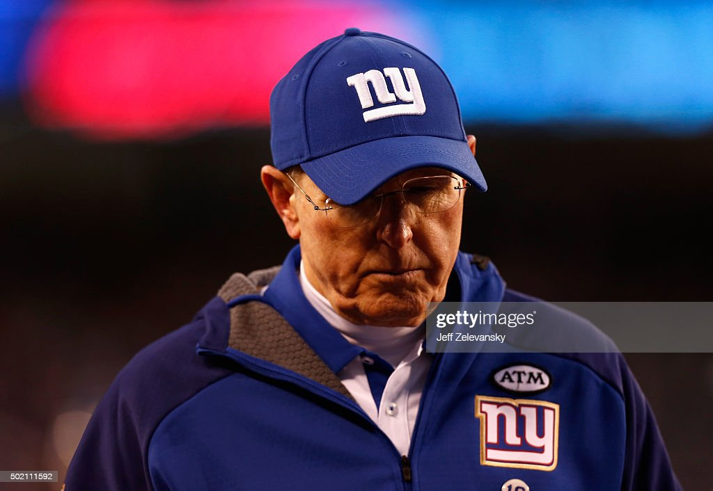 Head coach Tom Coughlin of the New York Giants walks off the field after being defeated by the Carolina Panthers in their game at MetLife Stadium on December 20, 2015 in East Rutherford, New Jersey. The Carolina Panthers defeated the New York Giants with a score of 38 to 35.