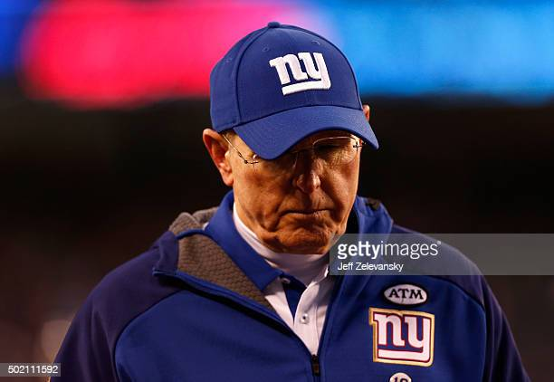 Head coach Tom Coughlin of the New York Giants walks off the field after being defeated by the Carolina Panthers in their game at MetLife Stadium on...