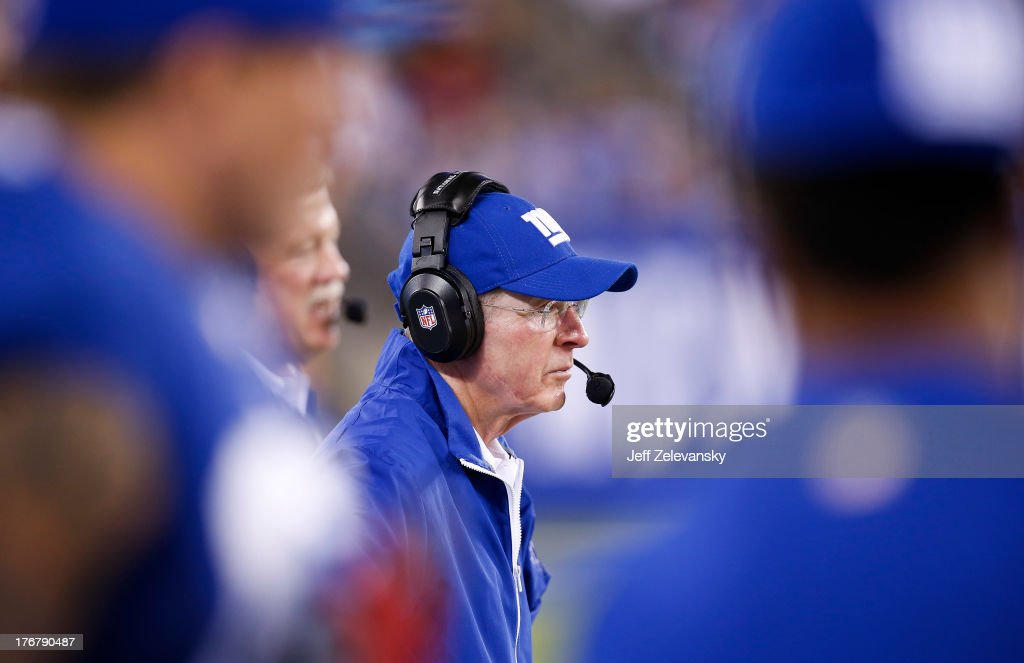 Head coach Tom Coughlin of the New York Giants works on the sidelines during their preseason game against the Indianapolis Colts at MetLife Stadium on August 18, 2013 in East Rutherford, New Jersey.