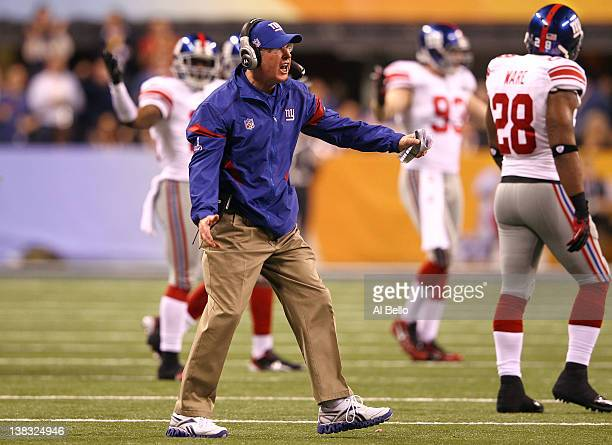 Head coach Tom Coughlin of the New York Giants yells to his team in the fourth quarter after a play against the New England Patriots during Super...