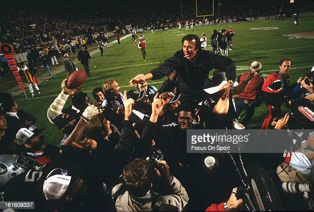 Head Coach Tom Flores of the Los Angeles Raiders gets carried off the field after they defeated the Washington Redskins 389 in Super Bowl XVIII on...