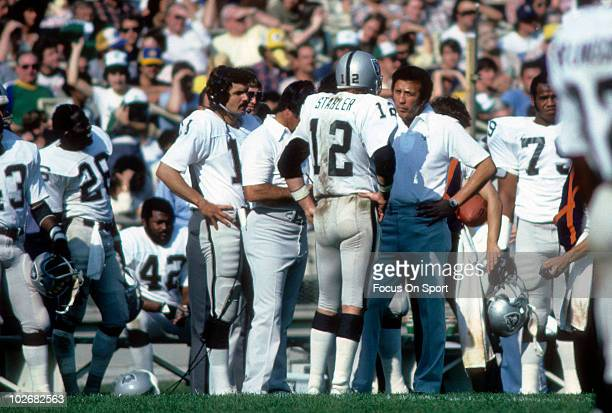 Head Coach Tom Flores of the Oakland Raiders talks with quarterback Ken Stabler circa 1978 during an NFL football game Flores coached the Raiders...