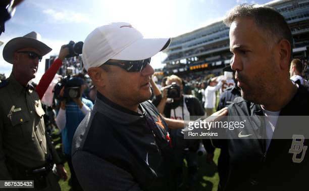 Head coach Tom Herman of the Texas Longhorns and head coach Matt Rhule of the Baylor Bears meet following Texas 387 win over Baylor at McLane Stadium...