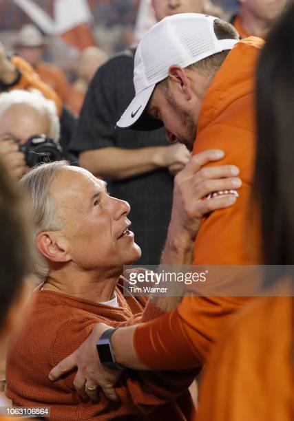 Head coach Tom Herman of the Texas Longhorns is greeted by Texas Governor Greg Abbott after the game against the Iowa State Cyclones at Darrell K...