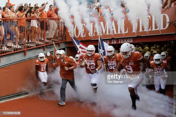 Head coach Tom Herman of the Texas Longhorns leads the team on to the field before the game against the Tulsa Golden Hurricane at Darrell K...