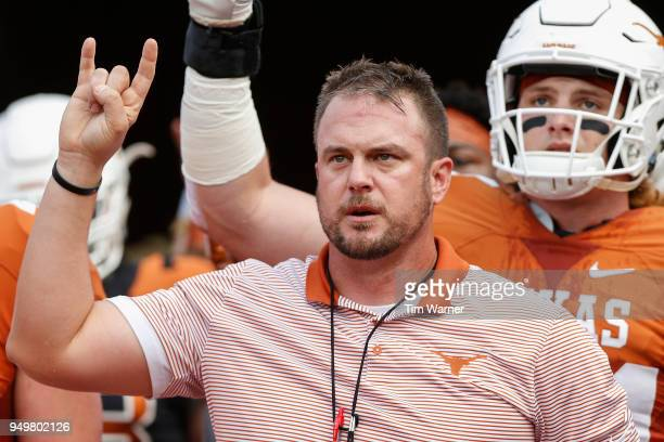Head coach Tom Herman of the Texas Longhorns leads the team on to the field before the OrangeWhite Spring Game at Darrell K RoyalTexas Memorial...