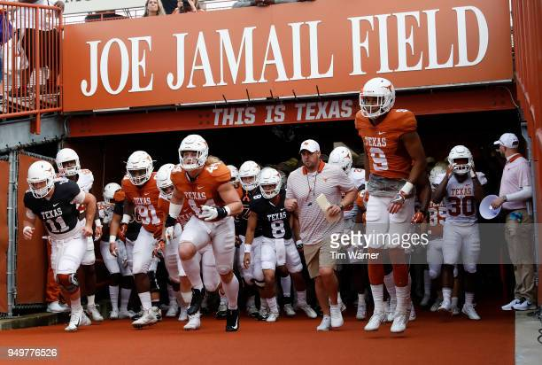 Head coach Tom Herman of the Texas Longhorns leads the team out of the tunnel before the OrangeWhite Spring Game at Darrell K RoyalTexas Memorial...
