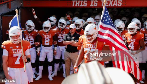 Head coach Tom Herman of the Texas Longhorns stands with the team before taking the field against the Maryland Terrapins at Darrell K RoyalTexas...