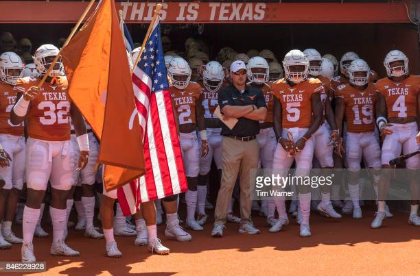 Head coach Tom Herman of the Texas Longhorns stands with the team prior taking the field against the San Jose State Spartans at Darrell K RoyalTexas...