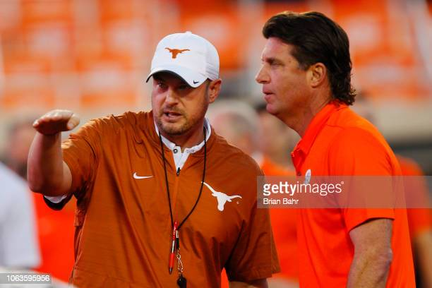 Head coach Tom Herman of the Texas Longhorns talks with head coach Mike Gundy of the Oklahoma State Cowboys on October 27 2018 at Boone Pickens...