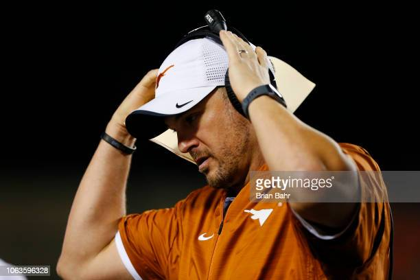 Head coach Tom Herman of the Texas Longhorns walks back to the sideline during a game against the Oklahoma State Cowboys in the second quarter on...