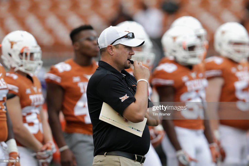 Head coach Tom Herman of the Texas Longhorns watches players warm up before the game against the Kansas State Wildcats at Darrell K Royal-Texas Memorial Stadium on October 7, 2017 in Austin, Texas.