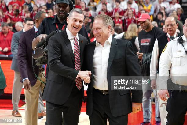 Head coach Tom Izzo of the Michigan State Spartans and head coach Mark Turgeon of the Maryland Terrapins talk before a college basketball game at the...