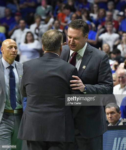 Head coach Tom Izzo of the Michigan State Spartans and Head coach Bill Self of the Kansas Jayhawks embrace after the game during the second round of...