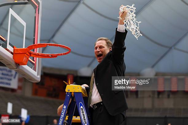 Head coach Tom Izzo of the Michigan State Spartans celebrates by cutting down the net after defeating the Louisville Cardinals 76 to 70 in overtime...