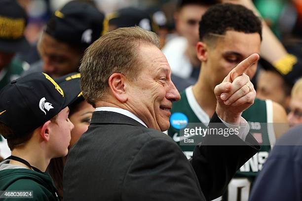 Head coach Tom Izzo of the Michigan State Spartans celebrates defeating the Louisville Cardinals 76 to 70 in overtime of the East Regional Final of...