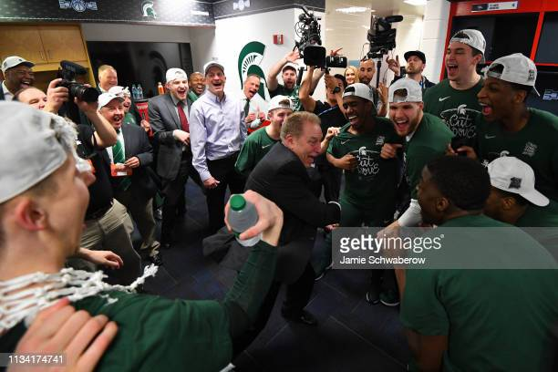 Head Coach Tom Izzo of the Michigan State Spartans celebrates with his team after defeating the Duke Blue Devils in the Elite Eight round of the 2019...