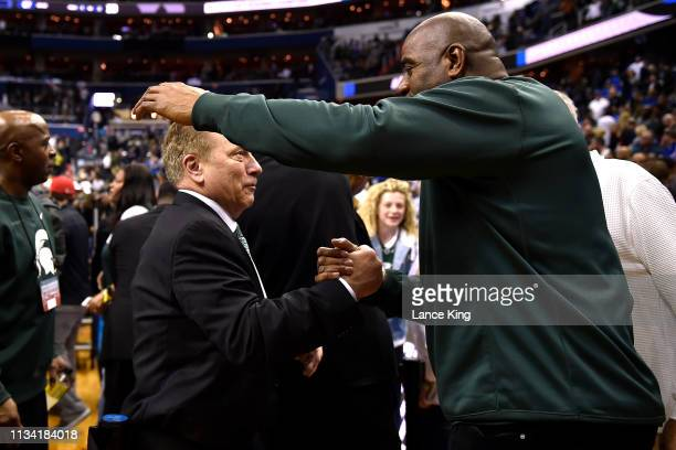 Head coach Tom Izzo of the Michigan State Spartans celebrates with Magic Johnson following their 6867 win against the Duke Blue Devils during the...